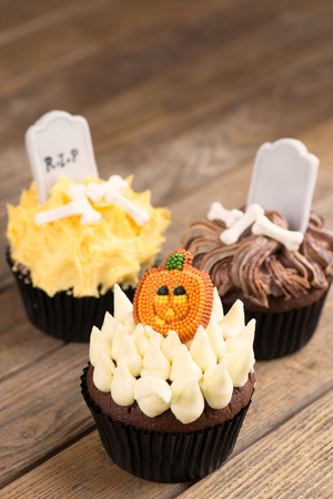 Colorful Halloween cupcakes close-up photo
