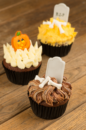 Colorful Halloween cupcakes close up photo