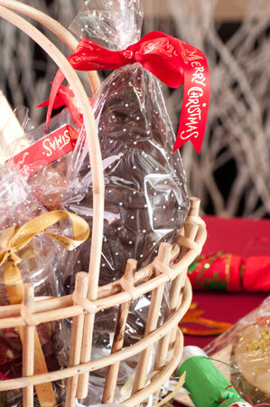 Christmas hamper basket with a chocolate Santa close-up photo