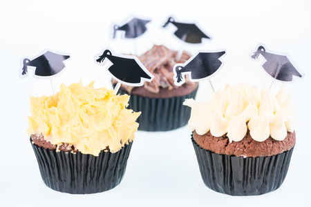 Graduation cupcakes with mortar board cake picks close-up photo