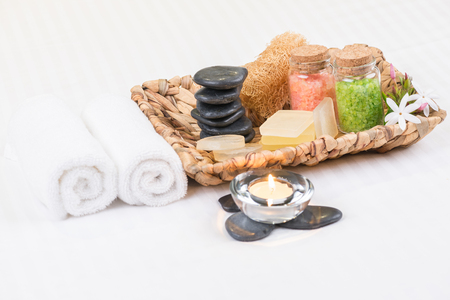 Bath salts, stones and soaps  in a basket close-up  photo