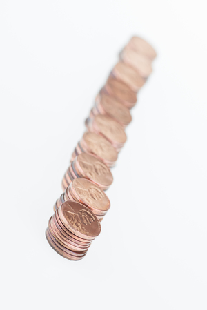 pennies: Stacked pennies in a row over white background  Stock Photo