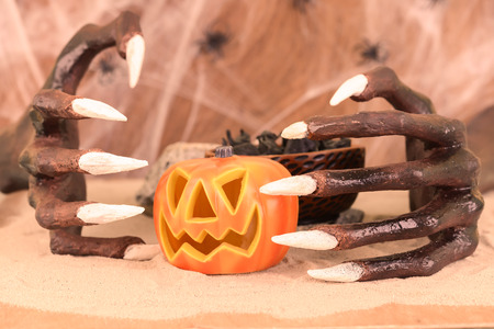 Halloween witch hands and Jack O Lantern ornament close-up photo