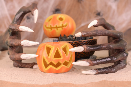 Halloween witch hands and Jack O Lantern pumpkin ornaments photo