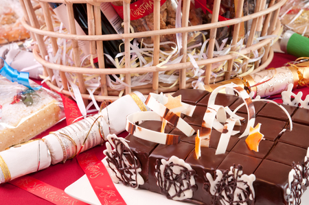 hamper: Christmas chocolate cake with a hamper basket at the background