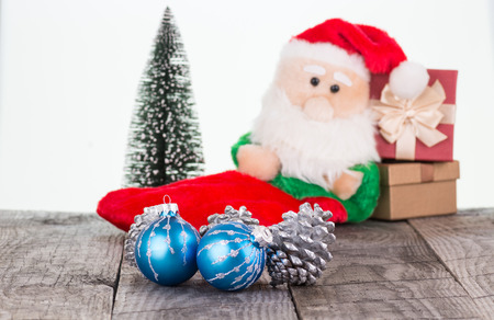 Christmas baubles and Santa Claus toy background photo
