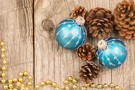 Christmas baubles, golden beads and pine cones photo