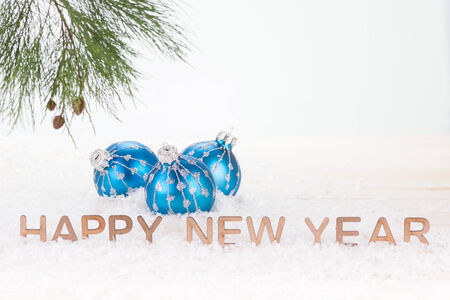 Blue Christmas baubles and  Happy New Year wishes photo