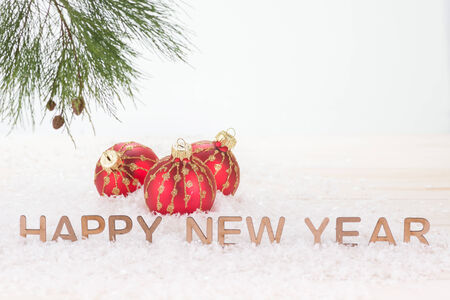 Red Christmas baubles and  Happy New Year wishes photo