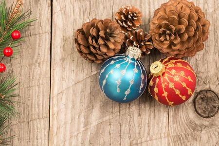 Red and blue Christmas baubles and pine cones photo