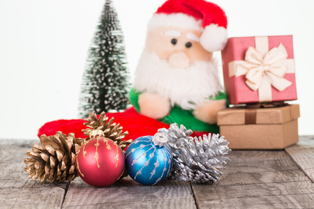Colorful Christmas baubles and Santa Claus toy background photo