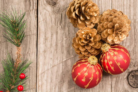 Christmas baubles and golden pine cones top view photo