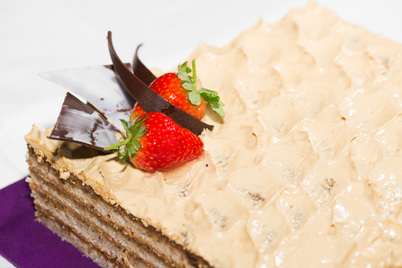 slice of cake: Walnut slice cake with chocolate chip cookie garnish Stock Photo