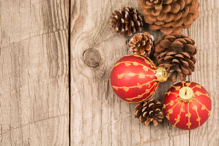 Christmas baubles and pine cones top view photo