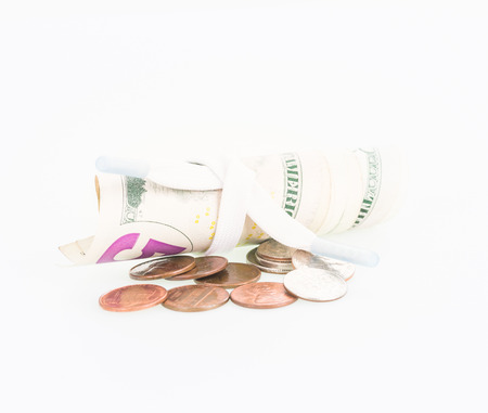 shoestring: Shoestring budget with US dollars and coins over white background