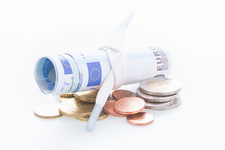 shoestring: Shoestring budget concept Euro banknotes and coins