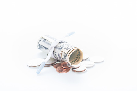 pennypinching: Shoestring budget concept with US dollars and banknotes