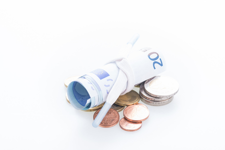 shoestring: Shoestring budget concept with Euro banknotes and coins
