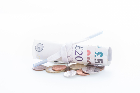 prudent: Shoestring budget concept with British Pound banknotes and coins Stock Photo