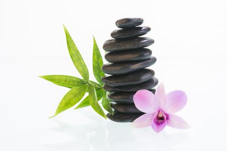 white stones: Black zen stone with Dendrobium orchid