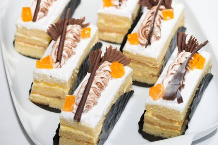 Vanilla sliced cakes with chocolate and orange marmalade garnish