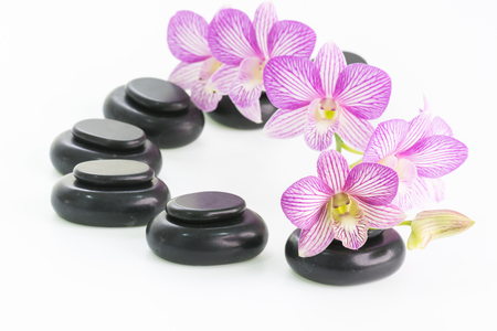 Spa with basalt stones and orchid flowers close up Stock Photo
