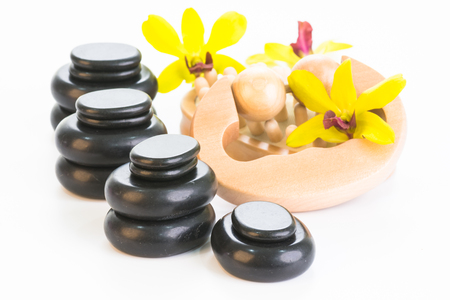 Spa treatment with hot stones, massage roller and cellulite massager