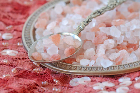 Himalayan pink salt over indian patchwork carpet