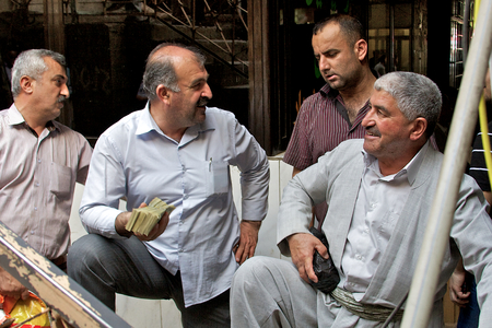 business for the middle: Financial negotiations in Iraqi Kurdistan. Due to large inflation and low denomination - hugh amounts of notes change hands. Iraq, Middle East