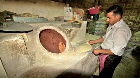 Bread baking in typical bakary in Middle East. Iraqi Kurdistan, Iraq Stock Photo - 22792723
