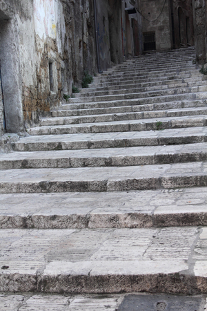 taranto: Stone staircase in the old city of Taranto, Italy. This section of the city dates to the Middle Ages and is being gradually renovated.