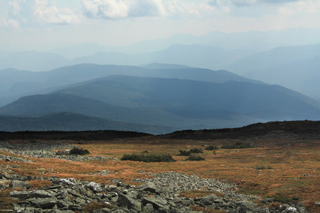 alpine tundra: White Mountains New Hampshire from the south slopes of Mt. Washington. The fragile arctic alpine habitat resembles the tundra of northern Canada. Row after row of blue mountains in the background. Stock Photo