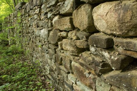 19th: Stone walls of a 19th century mill in Gay City State Park Hebron Connecticut close up horizontal. Stock Photo