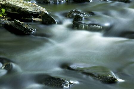 light streaks: Long exposure creates light streaks in the rapids of the Blackledge River in Gay City State Park Hebron Connecticut. Stock Photo