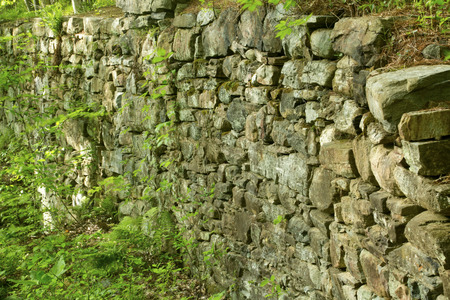 ghost rock: Stone walls of a 19th century mill in Gay City State Park Hebron Connecticut wide angle horizontal. Stock Photo