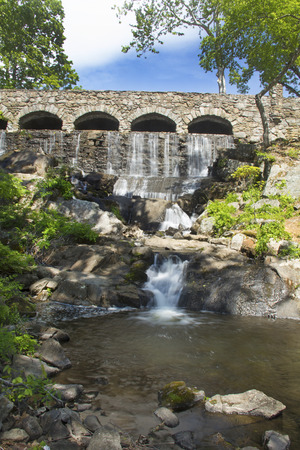 family owned: Stone bridge at Highland Park Falls of the Birch Mountain Brook on Spring St. in Manchester Connecticut. The park is named for the Case family which owned 19th century mills in this location.