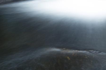 turbulence: Turbulence at base of Chapman Falls in long exposure, cascading onto rocks at Devils Hopyard State Park, Connecticut. Horizontal image.