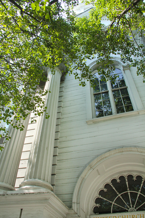 congregational: White facade, with columns, circular window and double, arched window, Congregational church, Keene, New Hampshire. Stock Photo