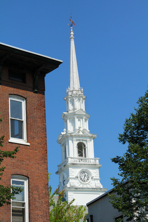 congregational: White steeple of the Congregational church, with clock, blue sky, Keene, New Hampshire. Stock Photo