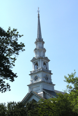 congregational: White steeple of the Congregational church emerging from trees, with clock, Keene, New Hampshire.
