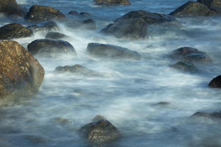 madison: Misty surf among rocks, with one large boulder, at Hammonasset Beach, Madison, Connecticut