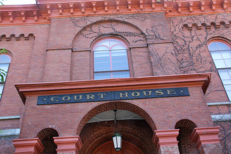 Red brick facade of the Court House, closeup, horizontal looking up, downtown Keene, New Hampshire.
