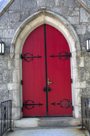 episcopal: Red, double doors of arched entrance to St. James Episcopal Church, downtown Keene, New Hampshire.