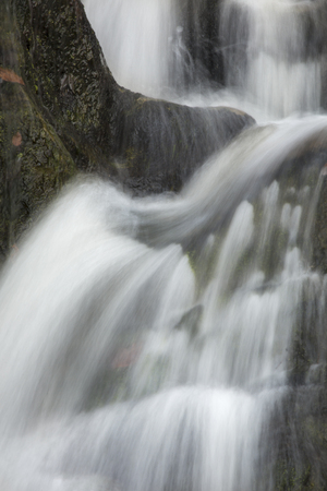 twisting: Closeup of main waterfalls at Kent Falls State Park in western Connecticut, with silky, twisting water from a long exposure.