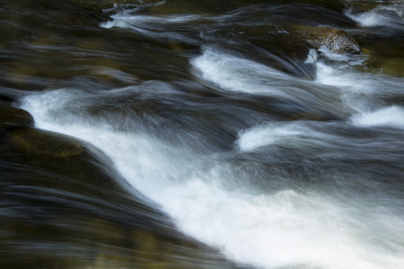 turbulence: Small rapids in the Sugar River, Newport, New Hampshire, with rocks and silky turbulence.