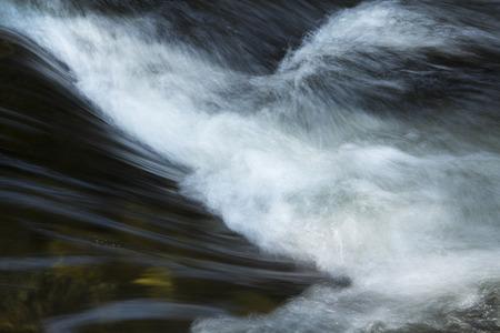 turbulence: Small rapids in the Sugar River, Newport, New Hampshire, with drop and silky, splashing turbulence, closeup. Stock Photo