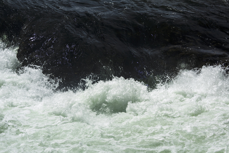 turbulence: Closeup of rapids, with whitegreen turbulence above Upper Falls of the Yellowstone River in Wyoming.