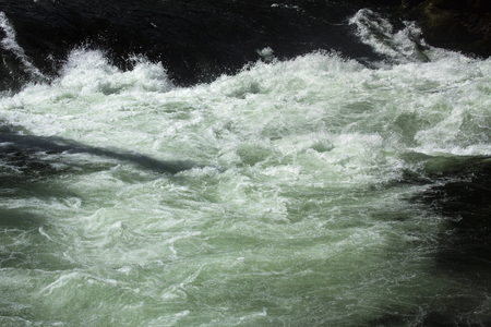 turbulence: Turbulence in the rapids below Upper Falls of the Yellowstone River in Wyoming. Stock Photo