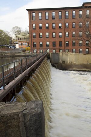 manufacturing: Dam on the Charles River, with the historic Boston Manufacturing Company mill building in the background, in Waltham, Massachusetts.