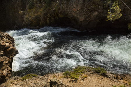 Rapids and cliffs above Upper Falls of the Yellowstone River in Yellowstone National Park, Wyoming.